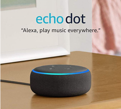 "A small, black, and round device roughly the size and shape of a small alarm clock.. A quote reads, ""Alexa, play music everywhere."""