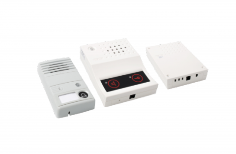 Three white-colored rectangular boxes with built-in speakers and input connections.