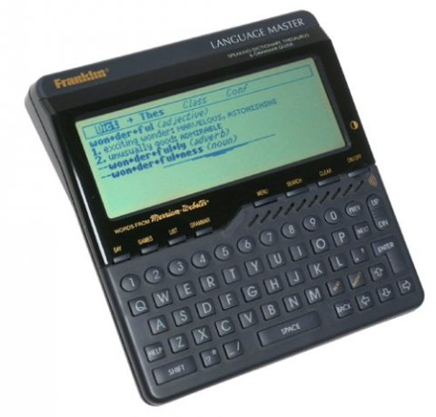 A black, medium-sized device resembling a calculator with a full QWERTY keyboard and large LCD display.