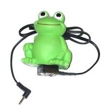 Green frog toy-like device connected to a standard cord and jack.