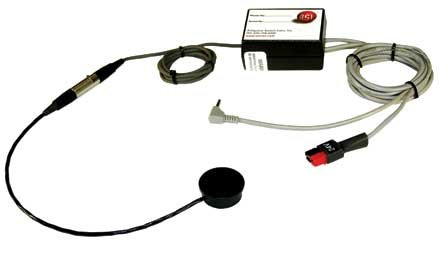 Small square device with white face and red indicator light in upper right. Attached is a long black cord with a round activation device at the end. Also attached are two more cables with different connectors.