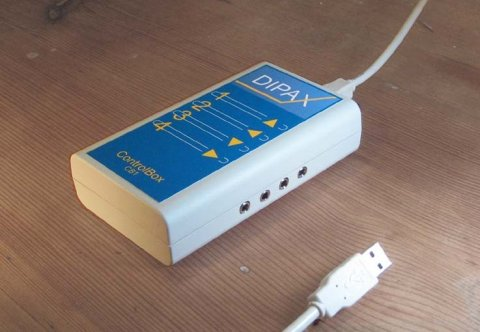 A small, rectangular, usb wired switch device with 4 jacks.