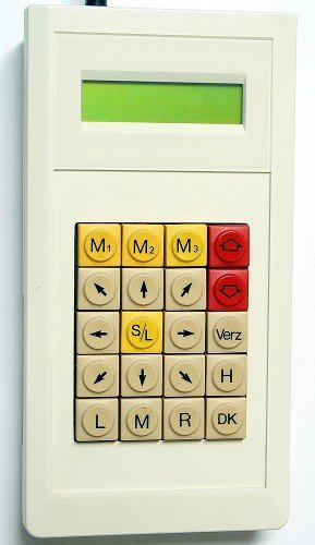 A handheld device that resembles a calculator with a small screen at top and eight directional buttons as well as other control buttons for a total of twenty buttons.