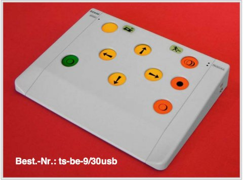 White rectangular control panel with 4 yellow buttons in the upper middle with arrow marks pointing right, left, top and bottom. There are 3 orange buttons on the right side and two buttons on the left, a yellow at the top edge and a green button parallel with the bottom orange button.