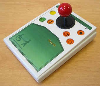 Rectangular device with three colored buttons on each side and a small joystick in the center and a surface below.