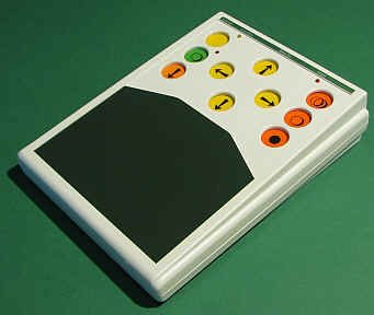 White, long rectangular device with 10 colored buttons on top and a surface area below.