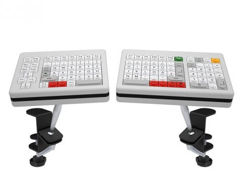 A split keyboard with each piece attached to a mounting arm and featuring control keys on the left side of the left piece and a keyboard on the right side of the right piece.