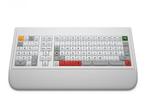 White computer keyboard with tan, black, and red keys; keypad at left; and, an integrated keypad.