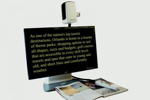 MultiView HD magnifying text from a magazine on to the monitor. The text is yellow on a black background.