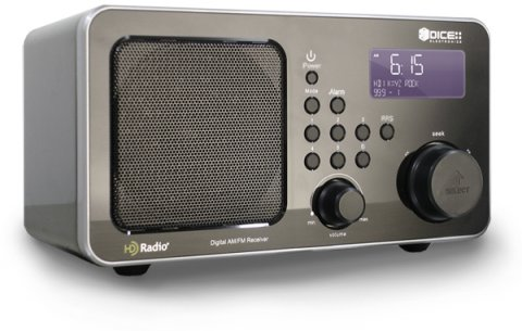 A medium-sized dark grey device resembling an old-fashioned radio, with two round dials, various menu buttons, a built-in speaker, and a small LCD display panel on the front.