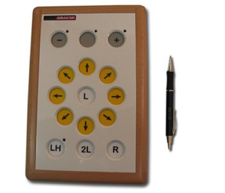 Overhead view of rectangular device with large buttons, yellow buttons with arrows arranged in a circle and additional controls along the top and bottom of device.