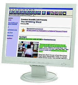 A white computer monitor displaying a web article with various portions of the text highlighted.