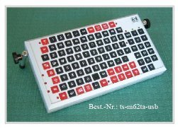 White keyboard-like device with red and black keys.