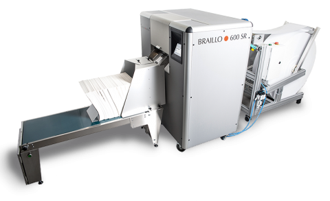 Large, white printing press with a long tray at the end for rapidly dispensing bulk printed materials.