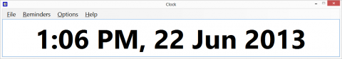 Long, narrow rectangular popup window with time and date displayed in large type.