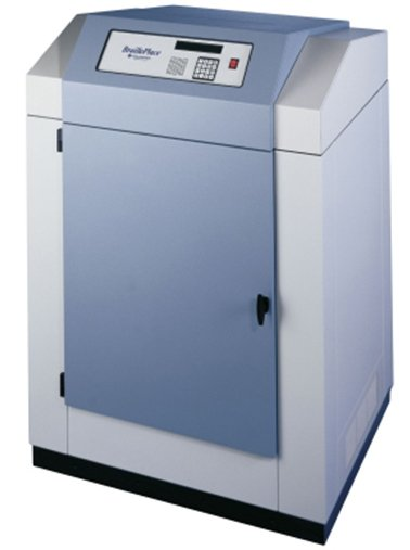 A large standing device that is white and grey in color and resembles a standard copy machine.