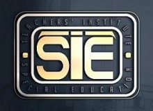 """The letters """"SIE"""" in gold, stylized font against a black background with two different-sized gold borders around it."""