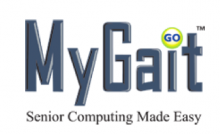 """The MyGait logo shown as one word with black text letters using a capital """"m"""" and """"g"""". The """"i"""" in g-a-i-t is dotted by a small white circle with the word """"GO"""" in capitals. Under its name  is written in small black text: Senior Computing Made Easy."""