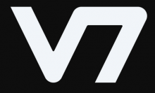 "The company Logo is written as a large ""v"" with the top of a 7 touching the top right leg of the ""V"", that is, the 2 characters are written as one and with no space between them."