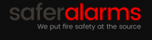 "The company name is written without spaces ""safer"" in gray and ""alarms"" in red. The tag line below the name is written in white text print, ""We put fire safety at the source""."
