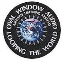 """The company logo, which features a black circle with a globe in the center. Around the circle are the words """"Oval Window Audio, Looping the World."""""""