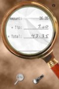 Screenshot of a magnifying glass graphic with a magnified photo showing a receipt in the center of the magnifying glass.