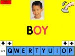 """A bright yellow screen with an image of a child and the word """"Boy"""" below in black and red font. A row of letters is at the bottom of the screen in blue, with two sets of up/down arrows on either side."""