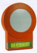 Orange colored circular device with a reflective area in the middle and control buttons at the bottom.