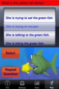 Screenshot showing a scrolling wheel at the top with a series of sentences and a colorful drawing of a green fish about to eat a smaller yellow fish on the bottom.