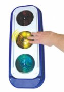 Picture of a traffic light shaped device with a hand pushing down on the middle yellow light.