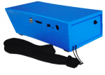 The back and left flank of a bright blue rectangular device. There are controls on the side: a switch, volume control dial, a recording button, headphone jack and the connector for the charging cable. There is also a carrying loop strap attached.