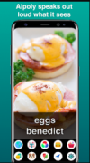 """Two dishes of prepared eggsin color on a phone's screen above the words """"eggs benedict."""" Under this is a 5x2 grid of round, colorful icons, including one for these: Text, Colors, Food, and Animal. The tag line above the phone reads as """"Aipoly speaks out loud what it sees""""."""
