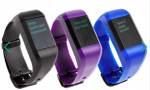 Three digital watches, each with a black face and a colored, plastic wristband that buckles: a black, purple and blue one.