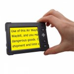 A hand holding a black video magnifier that has 4 lines of black text on a yellow background.