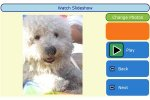 A photo of a dog on the left-hand side and play, back, next, and change photos menu options on the right.
