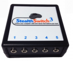 A rectangular device with five inputs on the front face and a Stealth Switch 3 logo of a game controller on the top face.