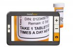 Rectangular, handheld device with large display and operating buttons along right side and magnified image of medication on screen.