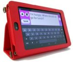 Rectangular handheld device with a red case and a text input screen with a keyboard on the display. It is sitting upright against a stand.