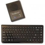 Small wireless keyboard and small rectangular speaker.
