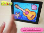 Front view of display screen that has a blue background, a yellow guitar, a starfish and seashell drawn on it.