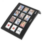 Rectangular black color device which has 12 switches, each switch has person's picture on it.