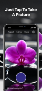 """Aflower on a mobile phone camera screen with a button to take a photo below. The caption reads """"Just Tap To Take A Picture."""""""
