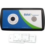 """A small rectangular device with a speaker on the right-hand side and a medium-sized round, black button on the left-hand side. The device is blue, green, and white, with black trim. The name """"6dot BrailleCoach"""" is printed above the speaker. Below the device are three small Braille-embossed tags, the foremost reads """"R, Letters 1, 2, 3, 5; Rather."""""""