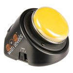 Black, round base with yellow button on top. The button base is sloped down toward the user.