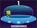 """Alien in UFO with subtitle below that reads, """"And now it's time to play."""""""