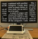 Magnifier with HDMI output plugged into left side. Magnifier is placed over a newspaper article with light shining to highlight the area being viewed. Magnified section of article displayed on LCD screen with white letters and black background.