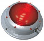 Gray base with red button and red lights around edge, silver knob on edge of button.