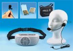 """Medium-sized off-white device that resembles a """"boom box,"""" with a black strap attached. There is also a """"telemarketer""""-style headset that fits over one ear and features a built-in mic. At the top, a small black microphone and a carrying bag are shown."""