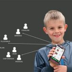 A young smiling boy holding a mobile phone with software features that have arrows pointing to highlights.