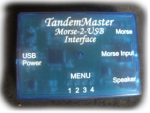 A rectangular device with labels like menu, speaker, USB power along its sides.